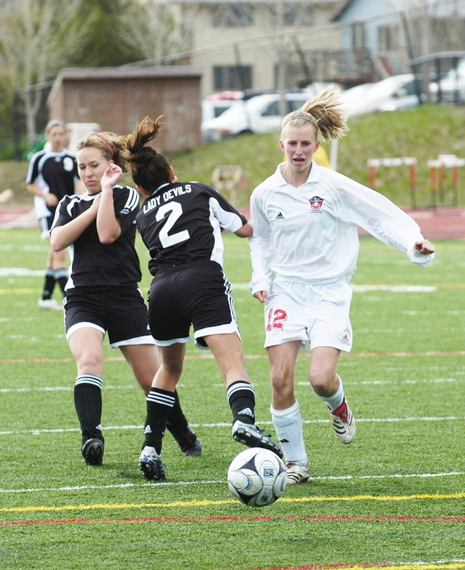 Steamboat Springs High School freshman Hope Scott passes by two Eagle Valley High School players Tuesday at Gardner Field. The Sailors won, 6-0.