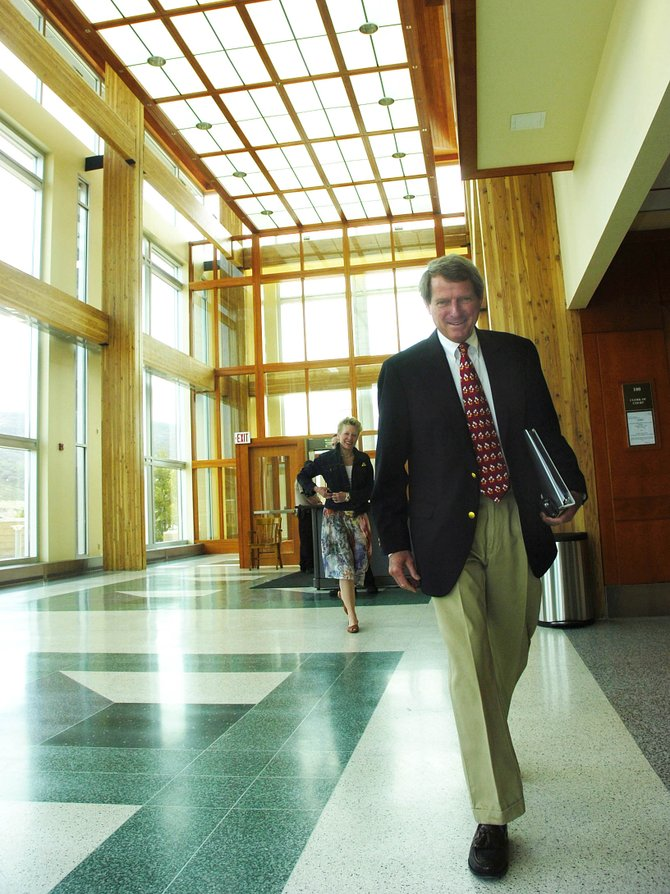 Routt County Sheriff Gary Wall heads toward a courtroom Tuesday at the Routt County Courthouse to attend a hearing regarding the revocation of his driver's license. The revocation was upheld.