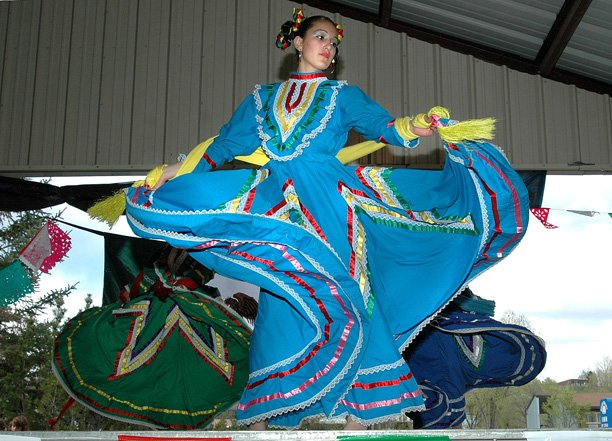 Nancy Delgago twirls her skirt during a Folklorico dance performance at the 2006 Cinco de Mayo celebration. This year's event runs from noon to 5 p.m. Saturday at the Moffat County Fairgrounds.