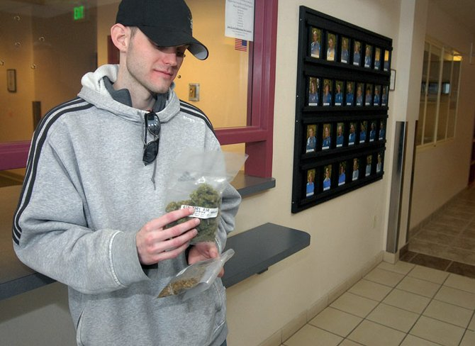 Tim Martin, 24, of Craig, retrieved two ounces of medical marijuana Thursday afternoon from Moffat County authorities. A Moffat County District Court judge ordered the marijuana, which was seized by the All Crimes Enforcement Team in October 2007, be returned to Martin, who is registered with the state's Medical Marijuana Registry program. Patients in the program are allowed to use the drug for medical purposes, such as severe pain.