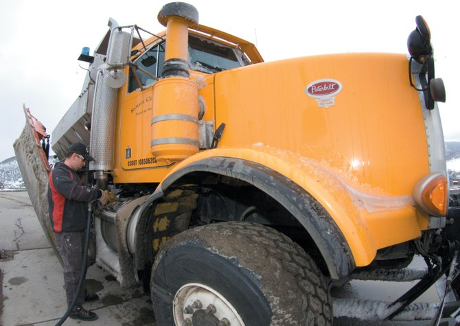 Routt County Road & Bridge mechanic Jason Bongiorno fuels up a plow truck Friday morning at the country shop in Steamboat Springs. Skyrocketing diesel fuel costs and a big winter have led the city and country to exceed fuel budgets.