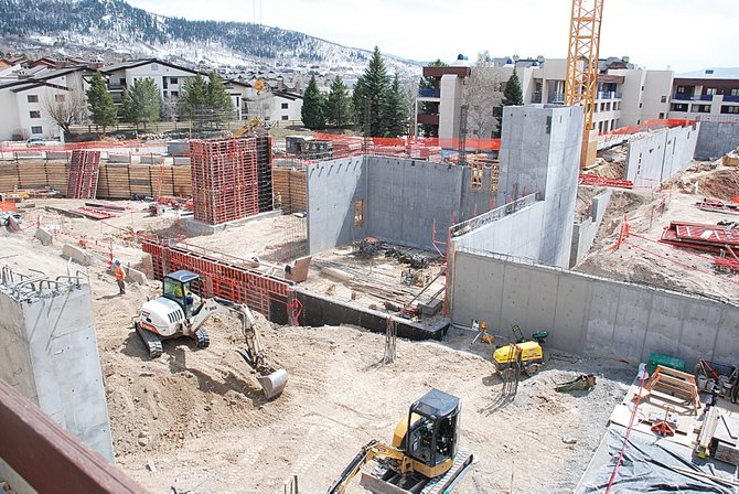 The site of the One Steamboat Place condominium project at the base of the ski area was alive with activity Wednesday. Workers are expected to pour the concrete slab for the swimming pool this week. The first truckload of structural steel is expected June 1.