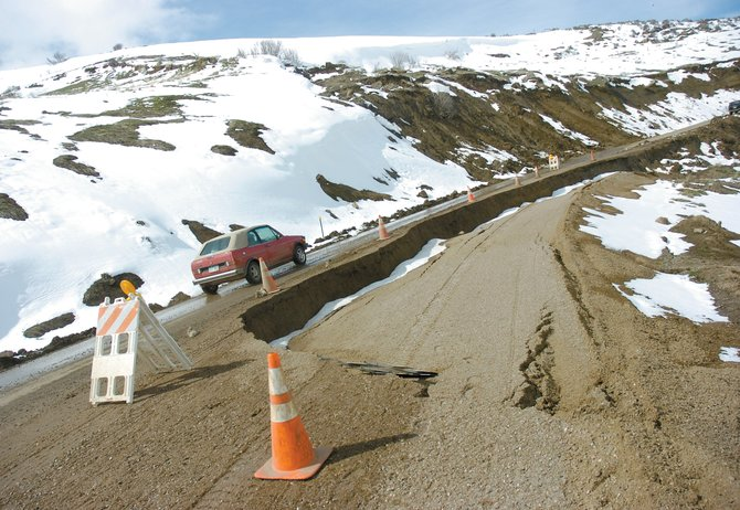 Part of Routt County Road 76 near Hayden is down to one lane because of a slide and runoff that has caused the road to deteriorate.