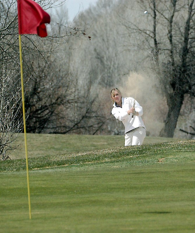 Moffat County High School senior Meghan Innes blasts out of a bunker last week in the Bulldog Invitational at Yampa Valley Golf Course. Innes carded a team-low 80 Tuesday at Devil's Thumb Golf Course in Delta in the girls 4A regional championships. Innes tied for first in the event after 18 holes, but she lost the first playoff hole on her way to a career-best second-place finish.