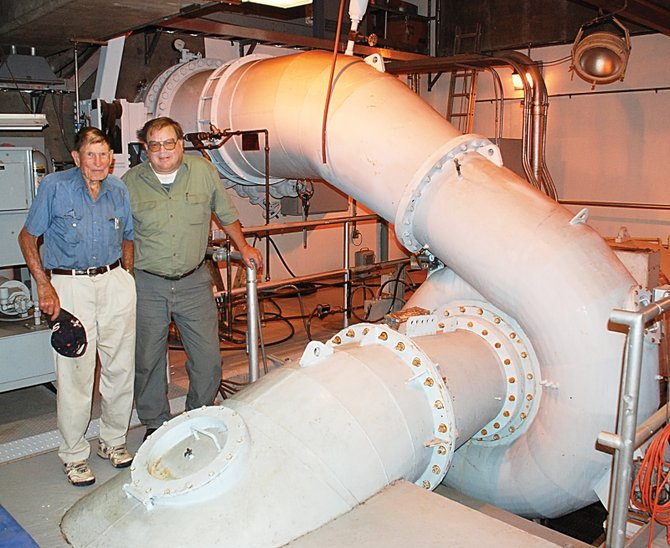 Upper Yampa Water Conservancy District General Manager John Fetcher, left, and Stagecoach Dam Manager Dan Ellertson inspect the turbine room in August 2007.