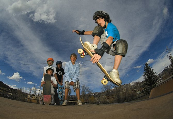 Reed Wipperfurth, 10, hits the ramp at the Howelsen Hill Skate Park Tuesday evening as his buddies, from right, Ben Kerrigan, Pike Wipperfurth, Will Kerrigan and Jake Sear watch.
