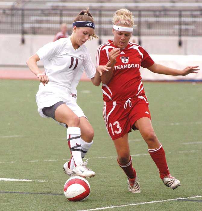 Cherokee Trail junior midfielder Melissa Fairchild, left, tracks down a loose ball in front of Steamboat Springs junior Elisa Anderson in the first half of a Class 4A girls soccer state playoff game Tuesday afternoon at Legacy Stadium in Aurora.