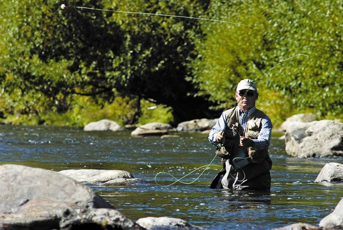 John F. Russell/Staff