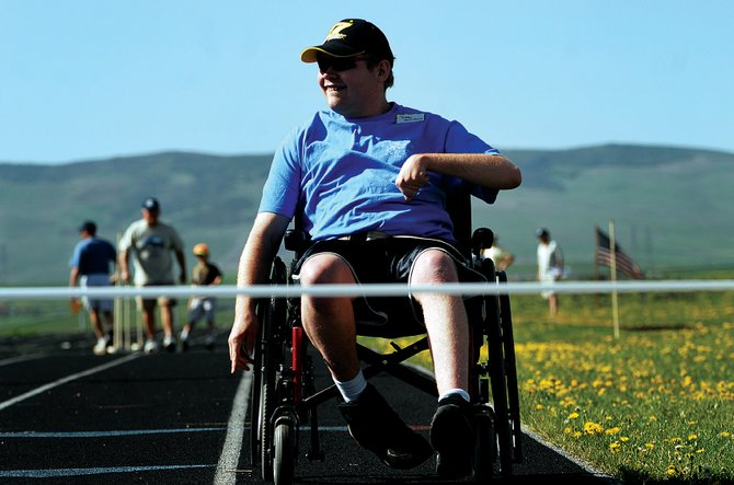 Bobby Holmberg, with Craig Horizons, crossed the finish line last year while competing in the 400-meter wheelchair race at the Special Olympics in Craig. This year's Special Olympics in Craig are today and Saturday.