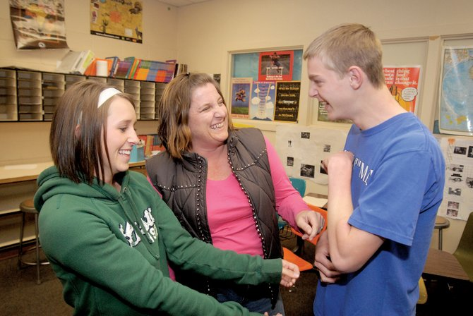 Tammy Rogers, center, is a single mom taking care of her two kids - Cassie, 18, left, and Cody, 16 - while being employed at Moffat County High School. Rogers, who works as a special education paraprofessional at the high school, said being a single mother was challenging at first but added that the experience has brought her family closer together.