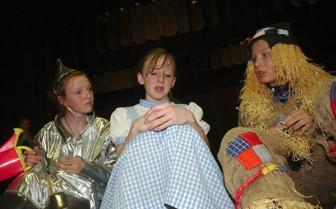 "Rehearsing for the Steamboat Springs Middle School production of ""The Wizard of Oz"" are, from left, eighth-graders Gaby Strnad, Kailee Duryea and Jake Barker."