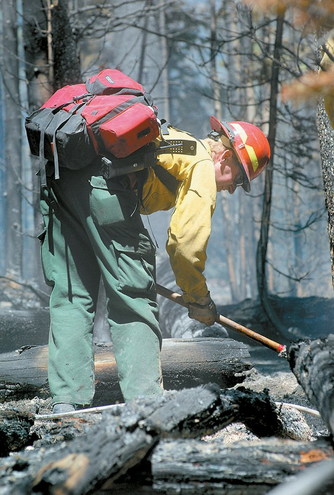 Firefighter Todd Like cleans up hot spots in the Buffalo Park Fire on Rabbit Ears Pass in July 2007. Routt County Emergency Management Director Chuck Vale predicts an average fire season.