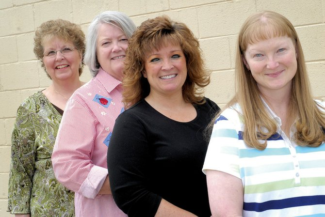 Deana Cheatham, far right, lost 51.5 pounds in The Memorial Hospital's Craig's Largest Loser competition. Cheatham is pictured with her team, the Dimple Dumpers, which includes, from left, Peggy Hough, Carla Seales and LaVan White. The team earned first place among all 19 team entries by losing 124 pounds total, or 10.69 percent body weight.