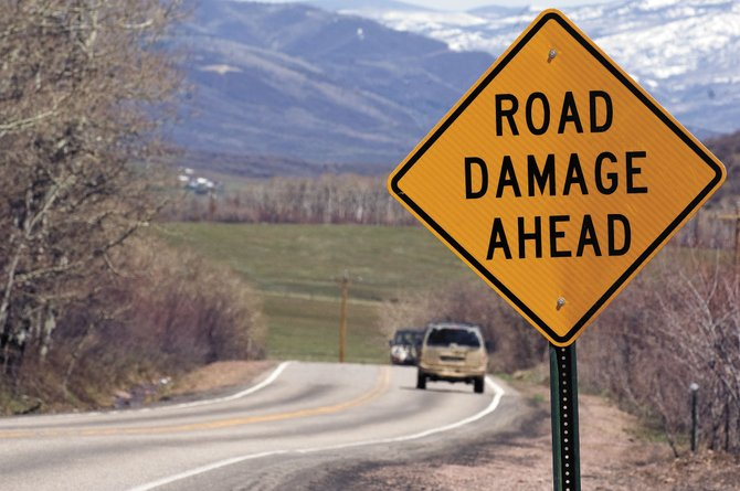 A sign warns drivers of road damage along Routt County Road 14 leading from Colorado Highway 131 to Stagecoach Reservoir. Road repairs were a topic conversation at a public meeting with county commissioners Tuesday at Oak Creek Town Hall.