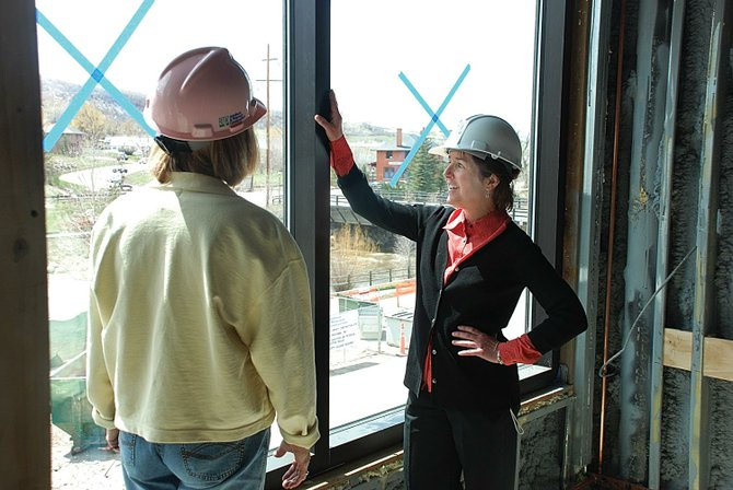Bud Werner Memorial Library Director Chris Painter, right, and board member Barb Ross admire views of the Yampa River and Depot Art Center from the second floor of the new library addition.