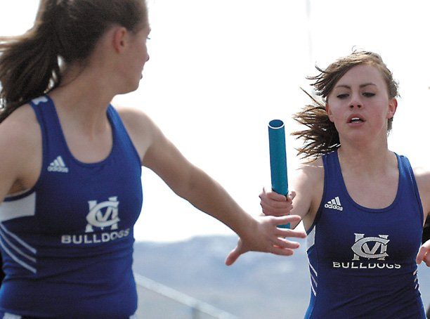 Moffat County High School junior Alicia Nelson awaits the handoff from teammate Katy Nottingham in the girls 4x800-meter relay April 26 during the Clint Wells Invite. The Bulldogs girls team placed second in the 4A regionals this weekend in Grand Junction.