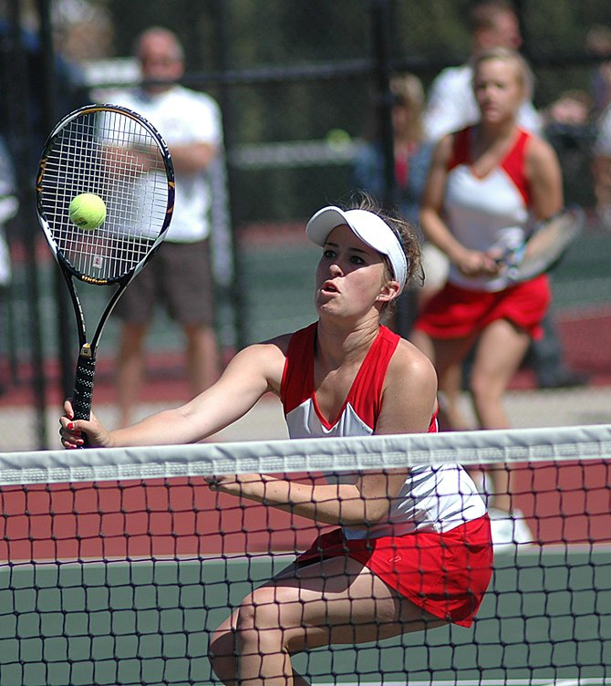 Steamboat's Kylee Swiggart taps a ball over the net Saturday at the state tennis tournament in Pueblo. Swiggart and her No. 1 doubles partner, Sara Bearss, lost the match, but the pair still finished fourth in the three-day event.