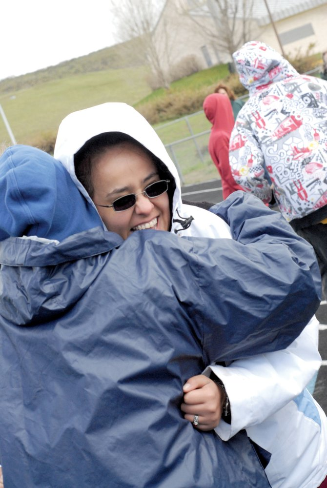Rosie Ramirez, of Montrose, hugs Nancy Morris, also of Montrose, after completing an exhibition race Saturday at Moffat County High School.