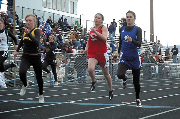 Moffat county high school junior Erin Urbanoski, right, races to the finish line in the girls 100-meter dash last month in the Clint Wells Invitational. Urbanoski qualified for the state championships in the 100 and is the defending girls 4A champion in long jump.
