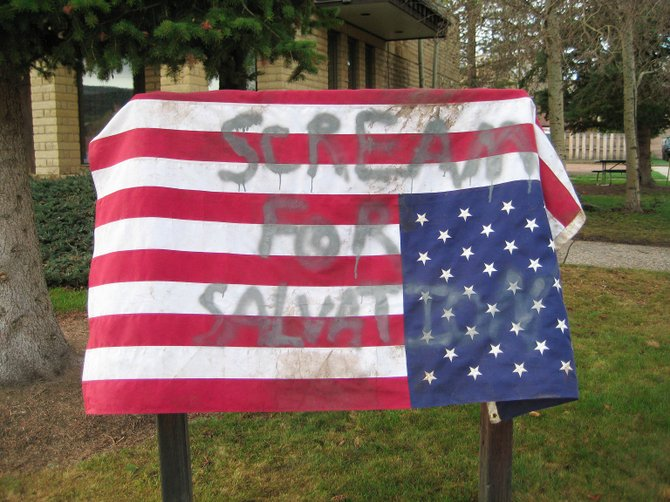 This American flag usually hangs at the fire station in Oak Creek but was found draped upside down on the sign outside Oak Creek Town Hall on Friday.