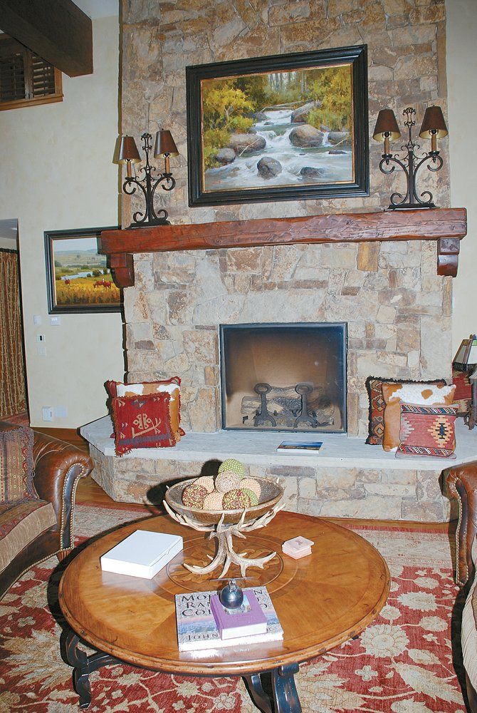 The home in Agate Creek Preserve includes a floor-to-ceiling Telluride gold fireplace.