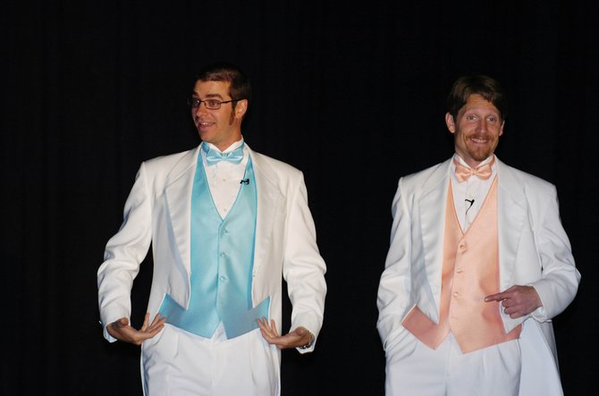 Kelly Anzalone shows off his tuxedo with fellow master of ceremonies Michael David at the beginning of Cabaret 2008.