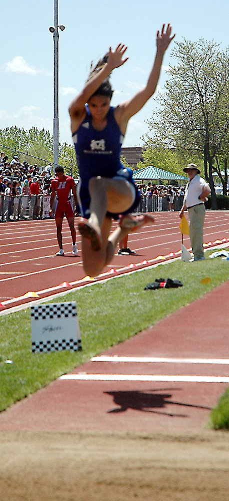 Erin Urbanoski, a Moffat County High School junior, goes airborne Saturday in the 4A girls long jump finals in Lakewood. Urbanoski entered the state tournament finals in Lakewood as the No. 1 seed and lived up to the high seed by earning her second consecutive state championship.