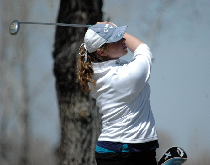 Moffat County High School sophomore Heather Nicholson watches her tee shot last month while participating in the Bulldog Invitational. Nicholson and senior Meghan Innes competed Monday in the girls 4A state golf championships at Rolling Hills Country Club in Golden.