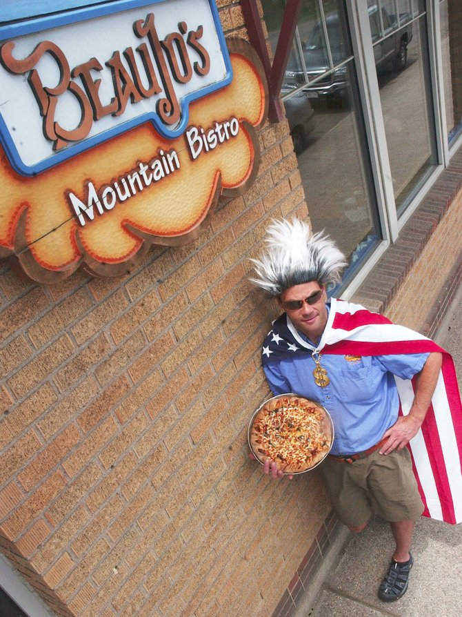 Beau Jo's Mountain Bistro manager Bill Doyne, dressed as his alter ego, Don Bling, displays a pie outside the restaurant Wednesday afternoon. The restaurant is hosting the Inaugural Mountain Pie Madness pizza-eating contest at 3 p.m. May 31.