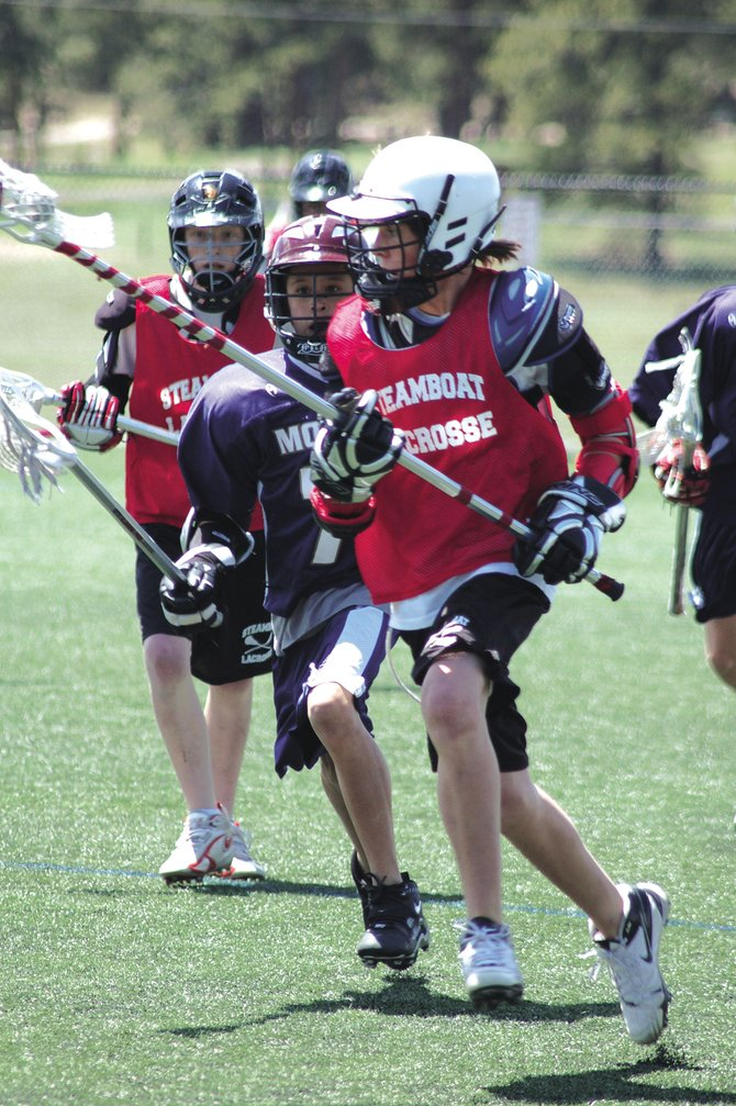 Penn Lukens advances the ball during a tournament last weekend in Evergreen. Steamboat Youth Lacrosse will host the fifth annual Steamboat Classic Lacrosse Tournament on Saturday and Sunday.