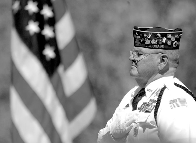 Bud Nelson holds his hand over his chest during last year's Memorial Day ceremony at the Craig Cemetery. This year's event is at 11 a.m. Monday at the Craig Cemetery and at 3 p.m. Monday at the Maybell Cemetary.