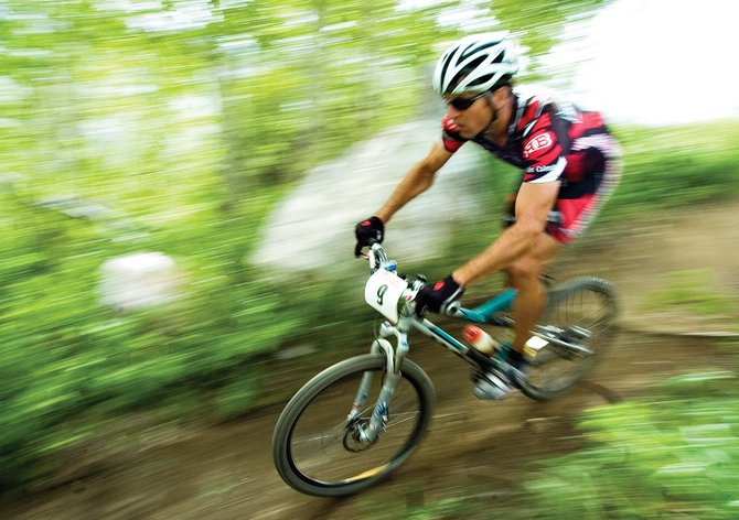 Brian Hannon cruises downhill through a stand of trees along the Valley View mountain bike trail at the Steamboat Ski Area in Steamboat Springs during last year's Rio Stampede. This year's race has been changed to six- and 12-hour races and moved to Aug. 9 to let trails dry.