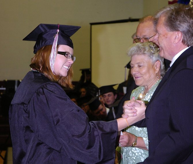 Soroco High School graduate Chelsea Worley is congratulated by South Routt School District Superintendent Kelly Reed on Saturday during graduation at the school.