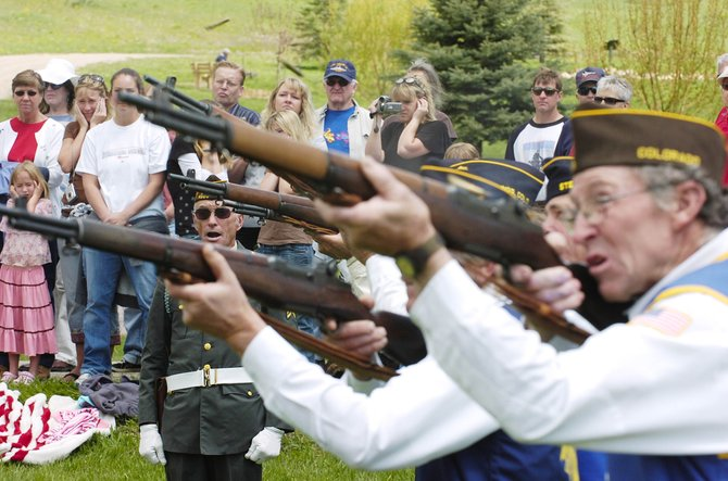 Rifle Squad Commander Doug Werner issues a command during the Memorial Day ceremony Monday at the Steamboat Springs Cemetery.