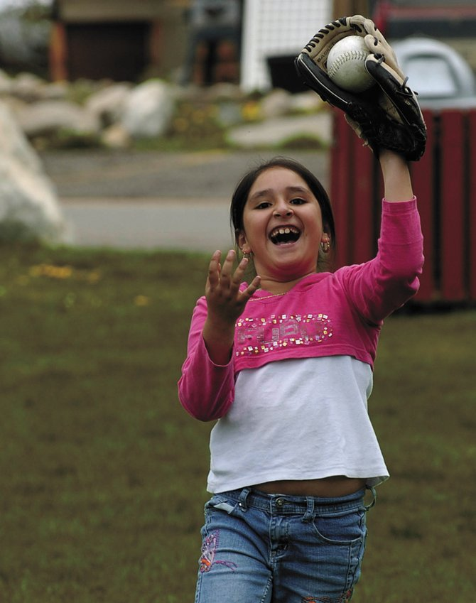 Eight-year-old Karen Cardenas catches a softball on Memorial Day in Little Toots Park. Karen was visiting Steamboat from Denver with her family.