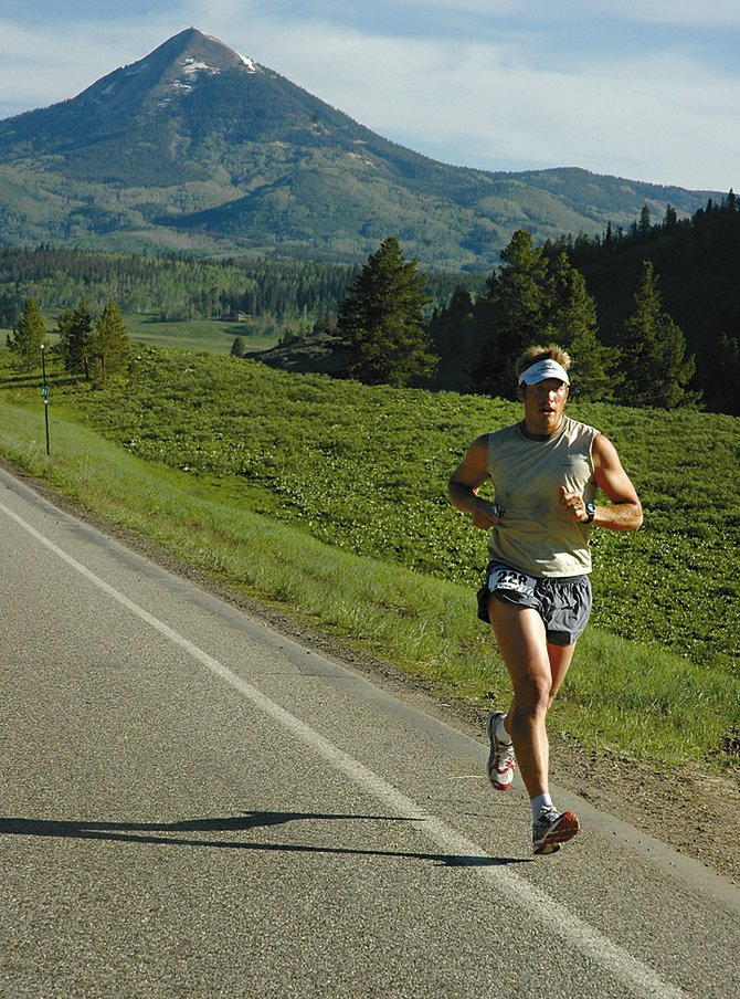 Steamboat Springs' Andy Picking makes his way from Hahn's Peak, pictured in the background, toward downtown Steamboat during the 2006 Steamboat Springs Marathon, when he finished second. Picking finished ninth last year.