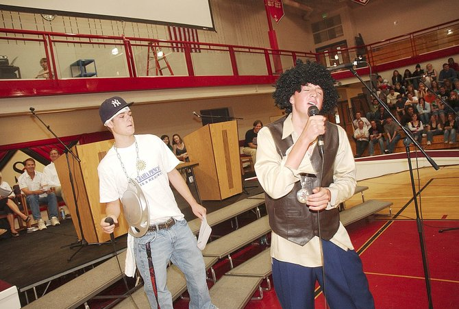 "Steamboat Springs High School seniors Kyle Steitz, right, and Greg Ingalls serenade fellow seniors with a unique version of Bill Withers' ""Lean on Me"" on Thursday during a senior assembly at the high school. Steamboat seniors will graduate at 2 p.m. Saturday at the high school."