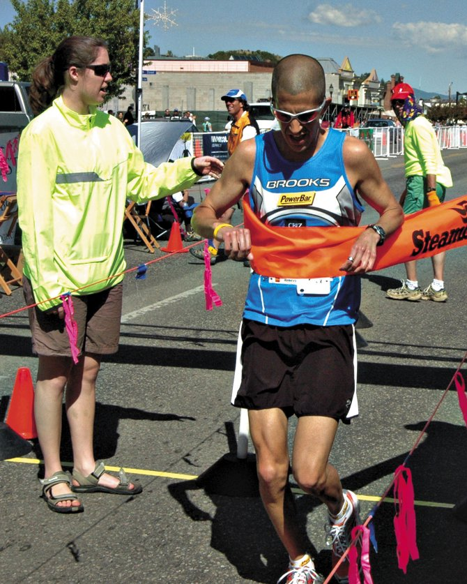 Jason Saitta, from Parker, crosses the finish line after finishing first in the 2007 Steamboat Marathon. Saitta has won the race seven times since 1999 and is trying for his eighth win today.