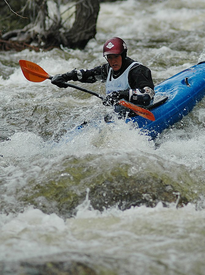Sarah Hamilton tries to navigate the boulders of Fish Creek last week in the Paddling Life Pro Invitational. Hamilton said she&#39;s grown to love kayaking since taking it up three years ago and hopes to eventually travel with the professional circuit. 
