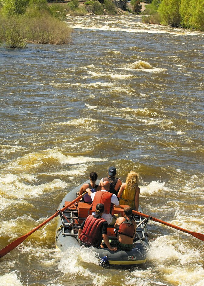 The fast-moving and frigid water of the Yampa River can be thrilling this time of year for rafters and kayakers, but it also can be very dangerous. This group of rafters was well prepared, with life vests and experienced crew members leading the way.