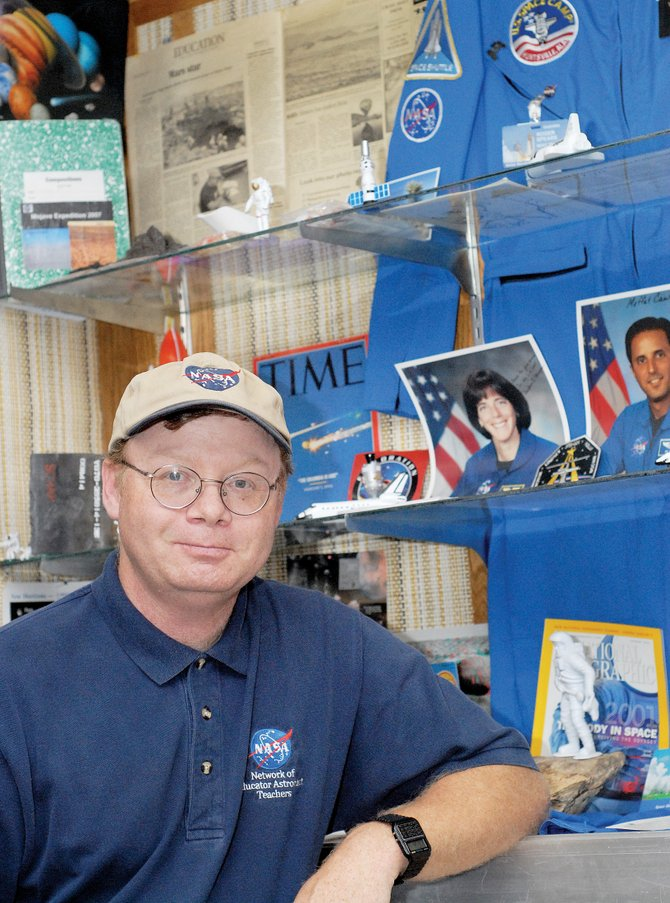 Roger Spears stands in front of the display of National Aeronautics and Space Administration memorabilia at Moffat County High School. Spears was chosen to mentor high school students interning with NASA scientists during a program running from June 16 to Aug. 8 at Florida's Kennedy Space Center.