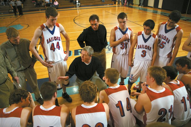 Steamboat Springs High School basketball coach Kelly Meek gives his last Sailors team some instructions during a timeout March 7, in a Class 4A playoff game against Pueblo West at Widefield High School. Meek has announced his retirement after 34 successful years coaching Steamboat boys basketball.