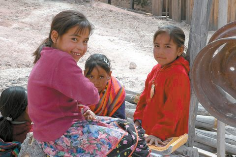 Three young girls sit earlier this year in Coreache, a village five hours west of Chihuahua City, Mexico, where a mission group from Steamboat Christian Center soon will travel with donated clothes, food and toys. The group also will construct the second floor of a school and offer medical services for minor ailments.