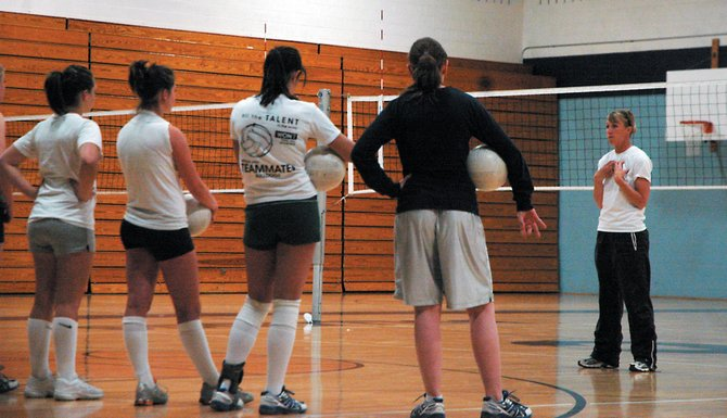 Moffat County High School girls volleyball coach Brianna Montgomery, right, addresses the team Wednesday night at practice. The Bulldogs are replacing five all-conference selections in Montgomery's second season at the helm.