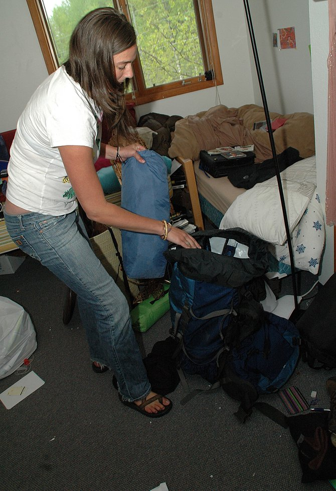 Lowell Whiteman senior Janis McLaughlin packs up her room Thursday afternoon. McLaughlin, originally from Estes Park, will graduate from the school Saturday with 17 of her classmates.