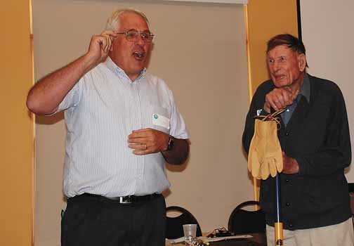 Upper Yampa Water Conservancy District board member Tom Sharp presents an inscribed irrigator's shovel to John Fetcher during the 2008 Water Forum.