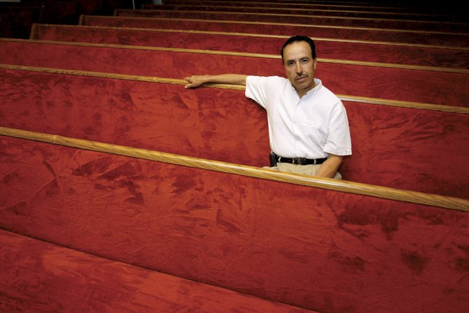 Arturo Villa, full-time Spanish-speaking pastor at Calvary Baptist Church, relaxes in one of the church's pews Monday afternoon. Villa has preached in the English-speaking service four times this year after former pastor Rod Compton left to lead another church in New Mexico. Members of a pastoral church committee are seeking Compton's replacement.