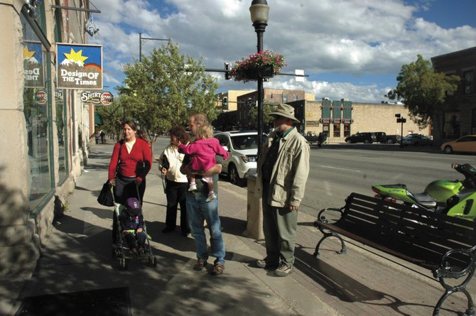 The Connor family from Denver takes an afternoon stroll along Lincoln Avenue on Sunday. Christie Connor pushes Cameron, 3, and John Connor holds Morgan, 1. Grandparents Audrey and Bill Bladt from Arizona came along. Officials from Mainstreet Steamboat Springs are asking the city for funding to improve the downtown area to keep bringing in tourists.