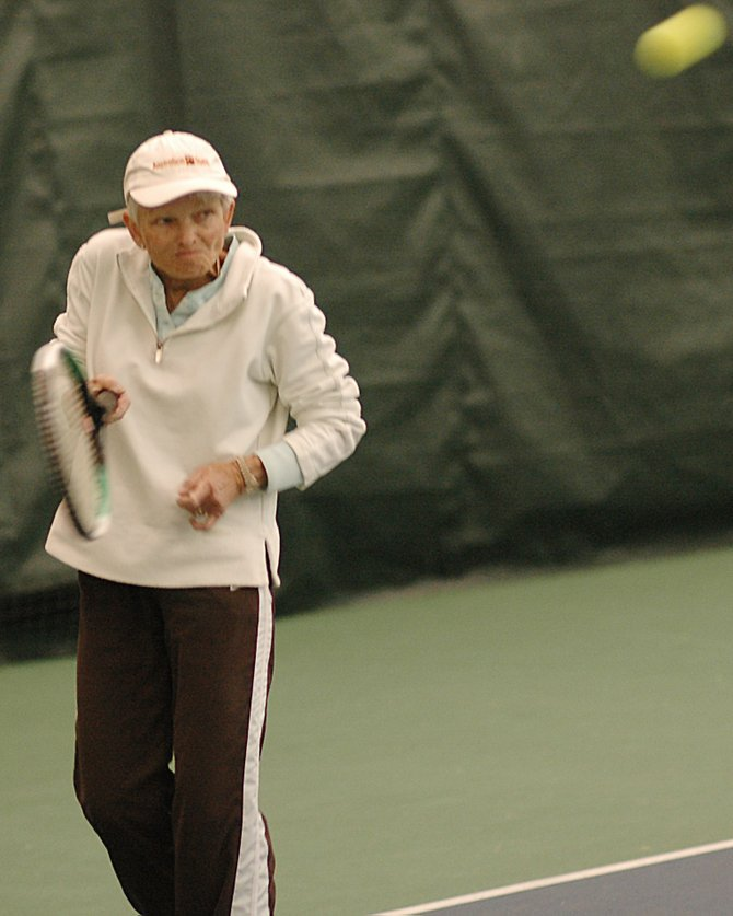 Kitty Gwathmey swings to return a ball Sunday at the Tennis Center at Steamboat Springs. Gwathmey, 69, was playing in the Intermountain Tennis Association's Senior Sectional Tennis Championships, and won the doubles bracket in her age division. She said it was the 16th consecutive year she's traveled to Steamboat for the senior's tournament.