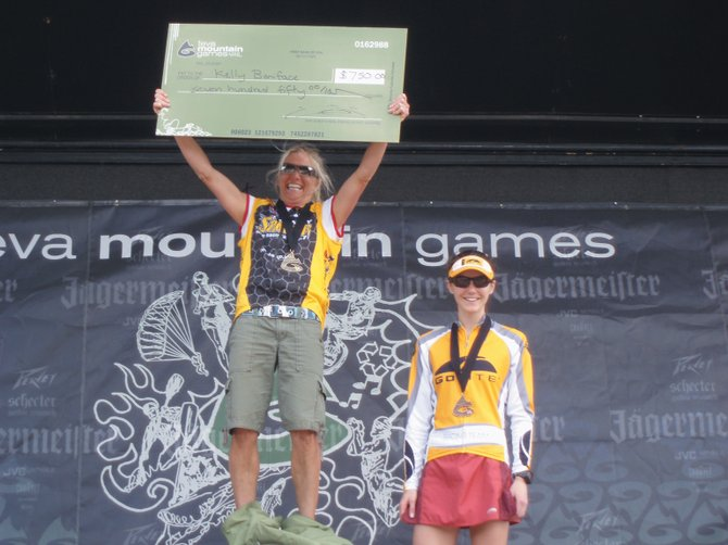 Kelly Boniface celebrates on the podium after her win Saturday in the cross-country mountain bike race at the the 2008 Teva Mountain Games in Vail. Boniface took home $750 for her win.